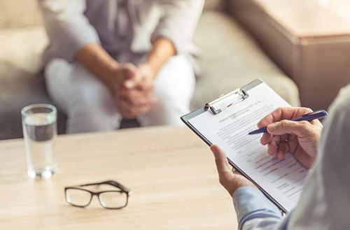nurse practitioner writing down medical information