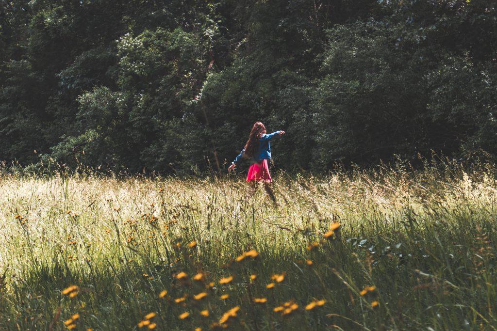 aloof woman in field