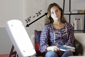 woman with seasonal affective disorder with sun lamp